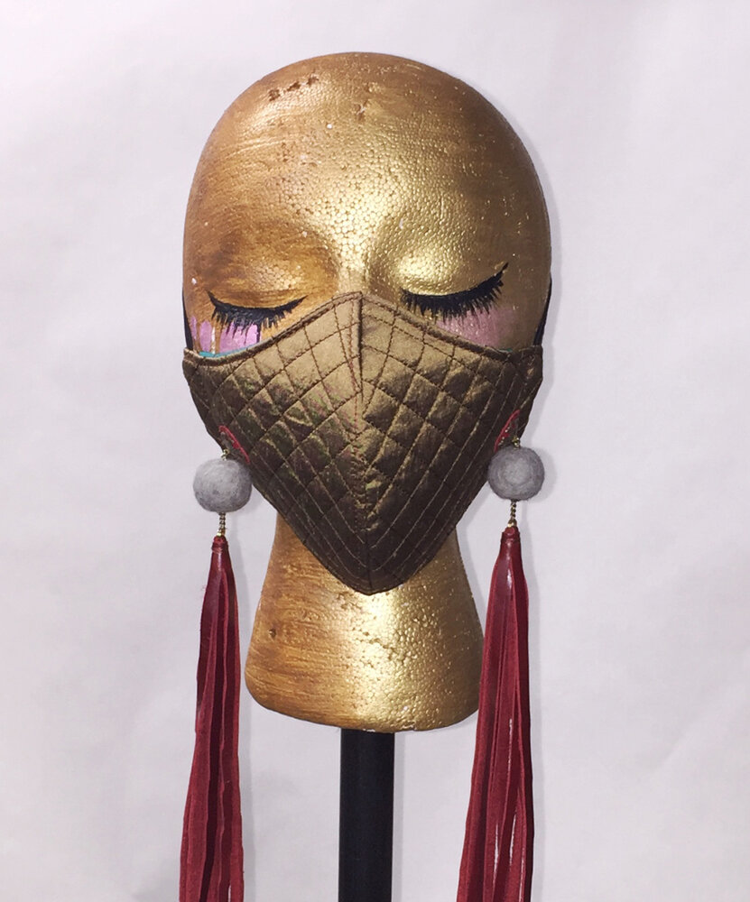 Tasseled And Quilted Mask Front View